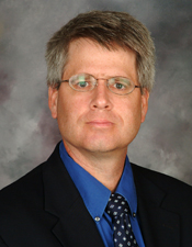 Devin S. Schindler, Professor, Auxiliary Dean