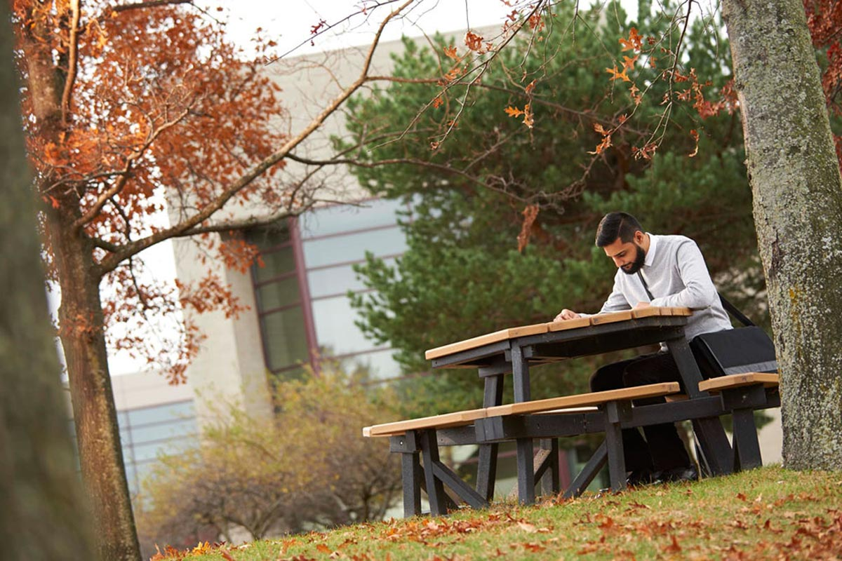 Studying on campus in Auburn Hills in the fall